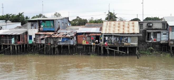 Maisons sur pilotis, delta du Mekong Vietnam